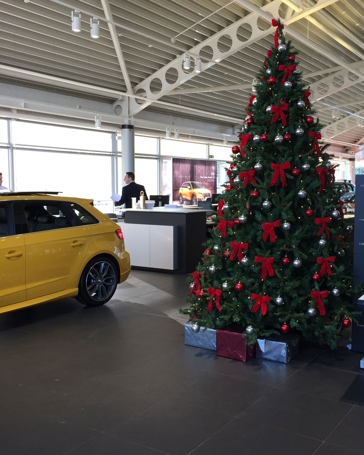 audi showroom christmas tree with red bows