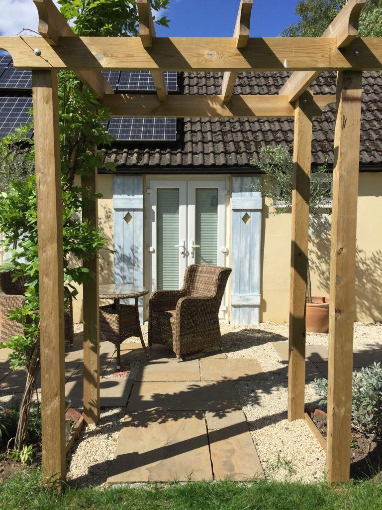 Finished pergola & paving in garden